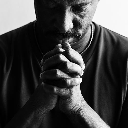 Image of a man praying