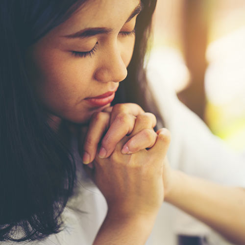 Image of woman praying